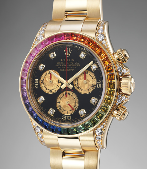 A very rare, heavy and attractive yellow gold, diamond and rainbow-colored multi-gem set chronograph wristwatch with bracelet, fitted presentation box and original guarantee