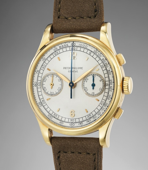 A very rare, large and attractive yellow gold chronograph wristwatch with silver dial and tachymeter scale