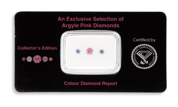 A Group of Three Unmounted Coloured Diamonds
