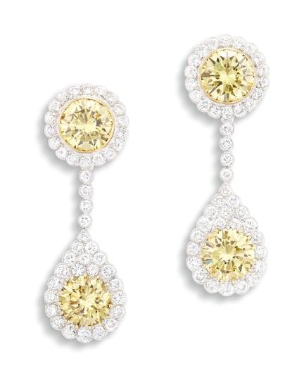 A Pair of Fancy Yellow Diamond and Diamond Earrings