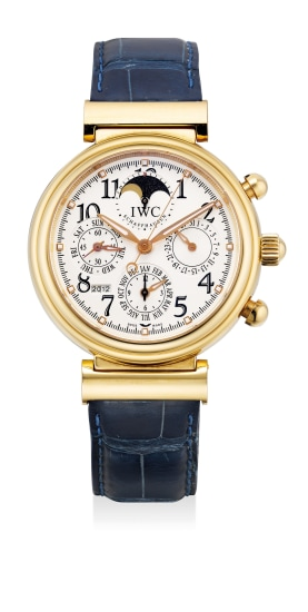 A fine and attractive yellow gold perpetual calendar wristwatch with year indication, moon phases, certificate and presentation box