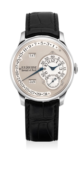 A fine and attractive platinum annual calendar wristwatch with retrograde date, day, month, small seconds, certificate and presentation box