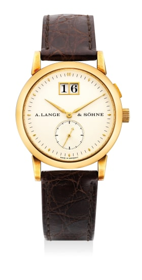 A fine and attractive yellow gold wristwatch with small center seconds, date, guarantee and presentation box