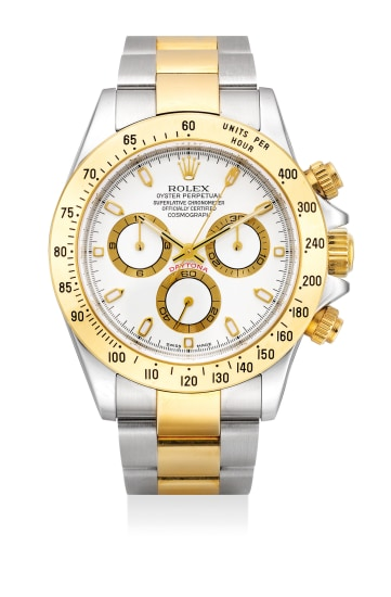 A fine and attractive stainless steel and yellow gold chronograph wristwatch with bracelet, guarantee and fitted presentation box.