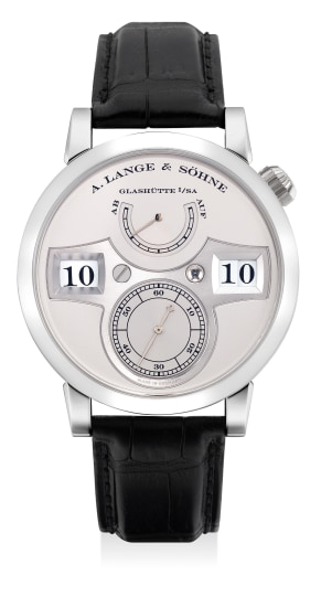 A very fine and rare platinum limited edition wristwatch with digital display, small center seconds, power reserve indicator, guarantee and presentation box, numbered 011 of a limited edition of 200 pieces