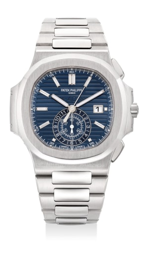 A very fine and rare limited edition white gold chronograph wristwatch with baguette diamond-set indexes, date, bracelet, Certificate of Origin and presentation box, made to commemorate the 40th Anniversary of the Patek Philippe Nautilus