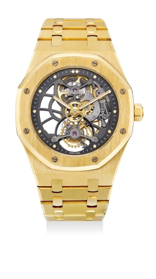 A very fine and attractive yellow gold skeletonized tourbillon wristwatch with bracelet, guarantee and presentation box