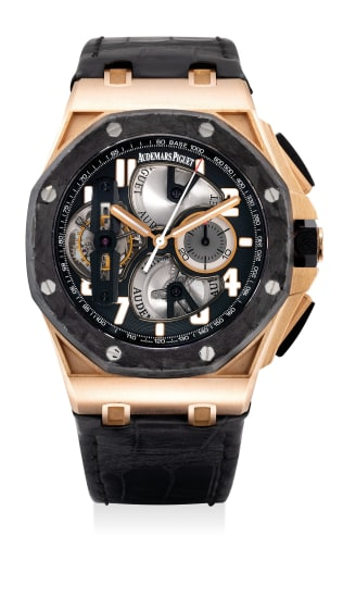 A fine and attractive pink gold, forged carbon and ceramic tourbillon chronograph wristwatch with guarantee and presentation box