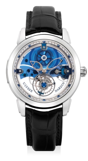 A very fine and rare limited edition platinum, sapphire and diamond-set skeletonized wristwatch with tourbillon escapement, numbered 86 of a limited edition of 99 pieces