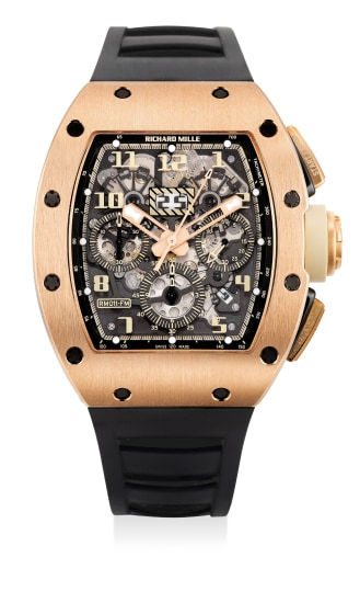 An attractive and very well-preserved pink gold skeletonized flyback chronograph wristwatch with date and month