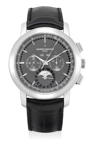 A very fine and attractive platinum perpetual calendar chronograph wristwatch with leap year indication, moon phases, certificate and presentation box