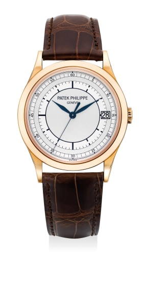 A fine and attractive pink gold wristwatch with date, two tone sector dial, sweep center seconds, certificate of origin and presentation box