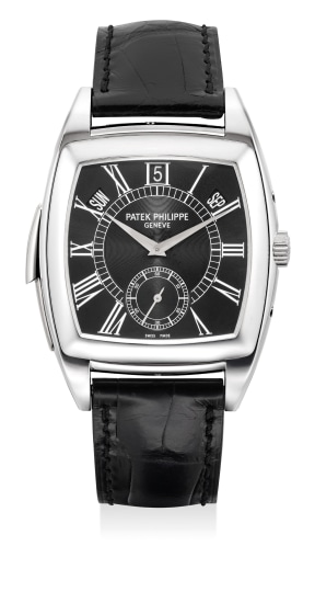 """An extremely fine and rare platinum tonneau-shaped """"Cathedral"""" minute repeating annual calendar wristwatch with small center seconds, certificate of origin and presentation box"""