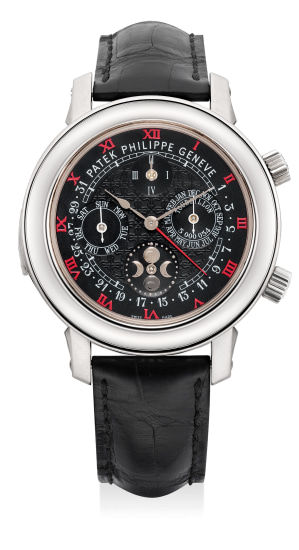 An extremely complicated, important and probably unique white gold double-dialed astronomical wristwatch with special dial with red Roman hour markers,  cathedral minute repeater, tourbillon regulator, perpetual calendar with retrograde date hand, leap year cycle, moon age, sky chart, sidereal time, meridian passage of Sirius, moonphases and moon orbit, certificate of origin and presentation box