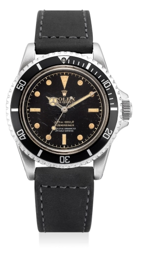 "A very rare and attractive stainless steel diver's wristwatch with sweep center seconds, black glossy ""four-liner"" dial"