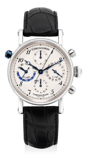 A fine platinum perpetual calendar chronograph wristwatch day and night indication, guarantee and presentation box