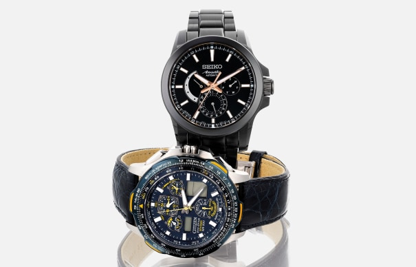 A lot of two limited edition automatic and digital wristwatches with guarantee and box