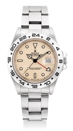 """A fine and rare stainless steel wristwatch with sweep center seconds, date, 24-Hour indication, """"cream' dial, bracelet, guarantee and presentation box"""