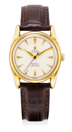 A fine and attractive yellow gold wristwatch with sweep center seconds