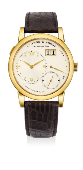 A fine yellow gold wristwatch with eccentric time and seconds, large date window and power reserve