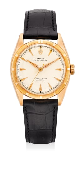 A fine and attractive pink gold wristwatch with sweep center seconds