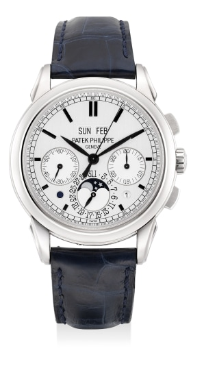 A very fine and attractive white gold perpetual calendar chronograph wristwatch with moon phases, leap year indication, day and night indication, Certificate of Origin and presentation box
