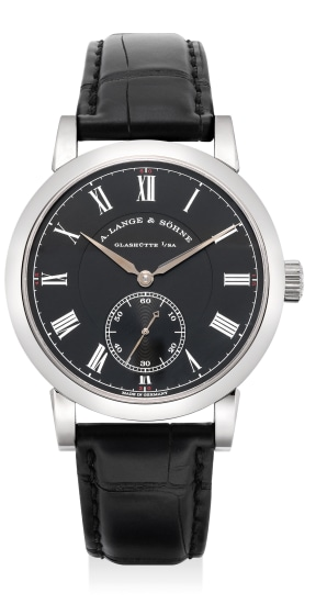 A fine and rare limited edition white gold wristwatch with small center seconds, guarantee and fitted presentation box, numbered 62 of a limited edition of 218 pieces