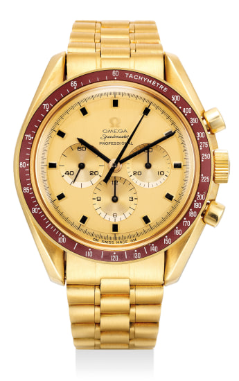 A very fine and rare limited edition gold chronograph wristwatch with burgundy bezel, Apollo XI engraved case back and bracelet, with original International guarantee, original bill of sales and Crater presentation box