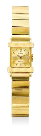 A lady's fine yellow gold rectangular-shaped wristwatch with integrated bracelet