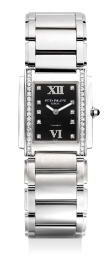 A lady's fine and attractive stainless steel and diamond-set wristwatch with bracelet, retailed by Tiffany & Co