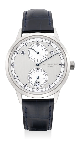 A fine and rare white gold annual calendar wristwatch with two-tone silvered regulator dial, certificate of origin and presentation box