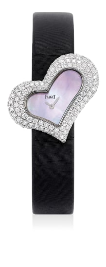 """A lady's elegant white gold and diamond-set heart-shaped wristwatch with """"mother of pearl"""" dial and presentation box"""