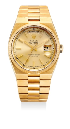 A fine and attractive yellow gold Quartz, wristwatch with sweep center seconds, day, date and bracelet