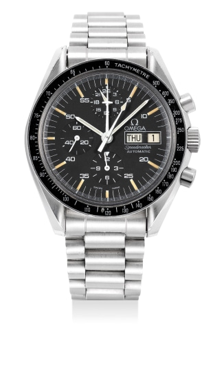 A fine and rare stainless steel chronograph wristwatch with day, date and bracelet
