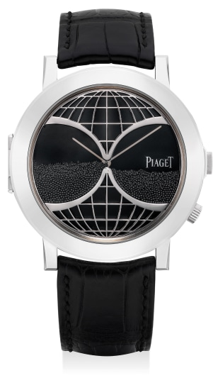"""A fine and unusual white gold wristwatch with """"hour glass"""" feature and concealed dial"""