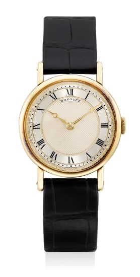 An attractive and rare yellow gold wristwatch with two tone guilloché dial