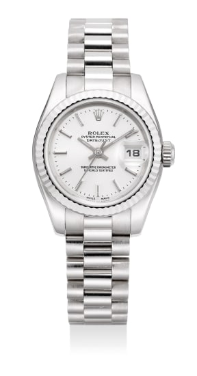 A lady's fine white gold wristwatch with sweep center seconds, date and bracelet