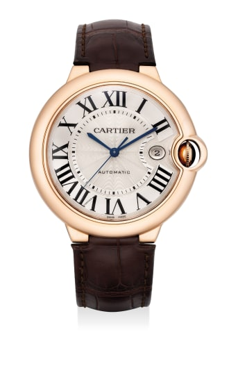A fine pink gold wristwatch with sweep center seconds and date