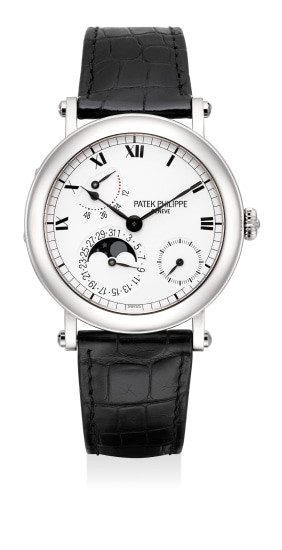 A fine and attractive white gold wristwatch, retrograde date, power reserve indication, moon phases, officier caseback, Certificate of Origin and presentation box