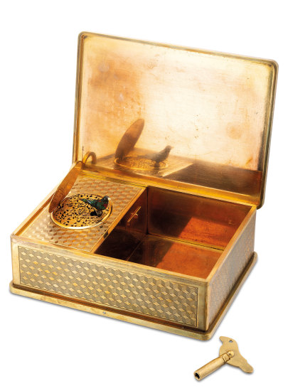 A very rare and highly attractive gilt metal singing bird cigarette box with winding key