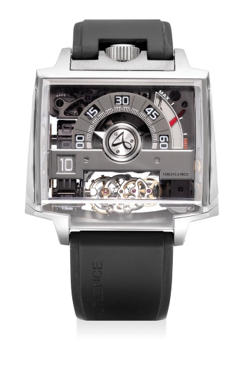 A very unusual and attractive limited edition skeletonized rectangular-shaped titanium and sapphire paneled wristwatch with jumping hours, retrograde minutes, 6-Hour rotating tourbillon escapement, power reserve indication, certificate and presentation box, numbered 18 of a limited edition of 88 pieces