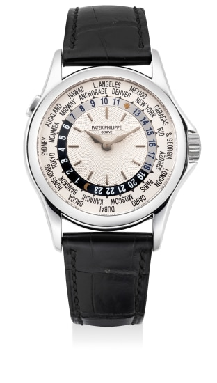 "A fine and attractive white gold world time wristwatch with ""guilloche"" dial, Certificate of Origin and presentation box"