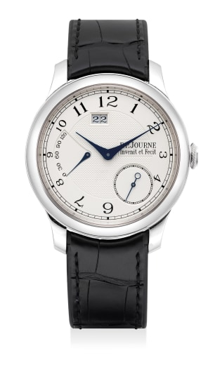 A very fine and attractive platinum wristwatch with date, power reserve indication, small seconds, certificate and presentation box