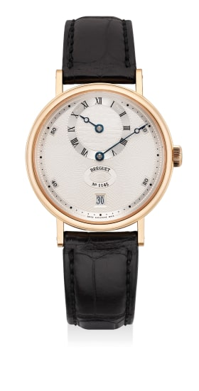 A fine and attractive pink gold wristwatch with date, regulator and guilloche dial