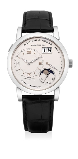 A fine and attractive platinum wristwatch with small seconds, oversized date, moon phases, power reserve indication, guarantee and presentation box