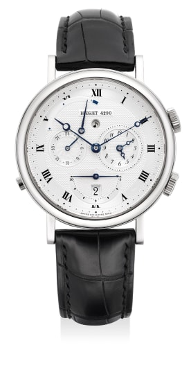 A fine and attractive white gold dual time wristwatch with alarm, 24-hours, power reserve indication and guilloche dial