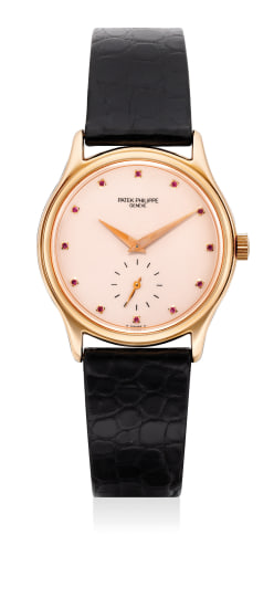 A fine and attractive limited edition pink gold and ruby-set wristwatch with Certificate of Origin and presentation box