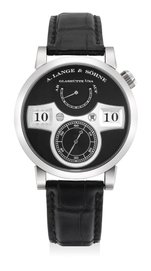A very fine and attractive white gold wristwatch with digital display, small center seconds, power reserve indicator, guarantee and presentation box