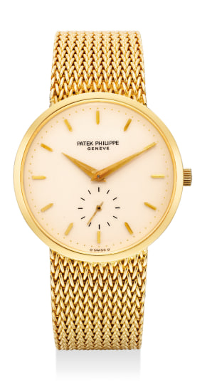 A fine and attractive yellow gold wristwatch with small center seconds, ivory color dial, integrated bracelet and Certificate of Origin