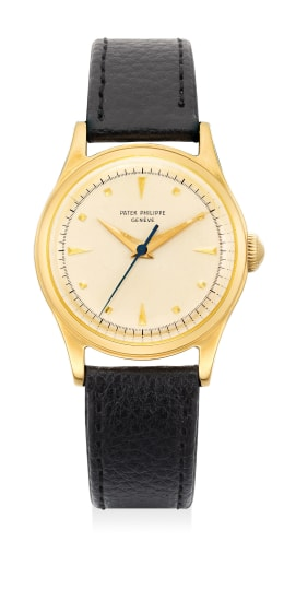 A very fine and rare yellow gold wristwatch with sweep center seconds and applied yellow gold hour markers